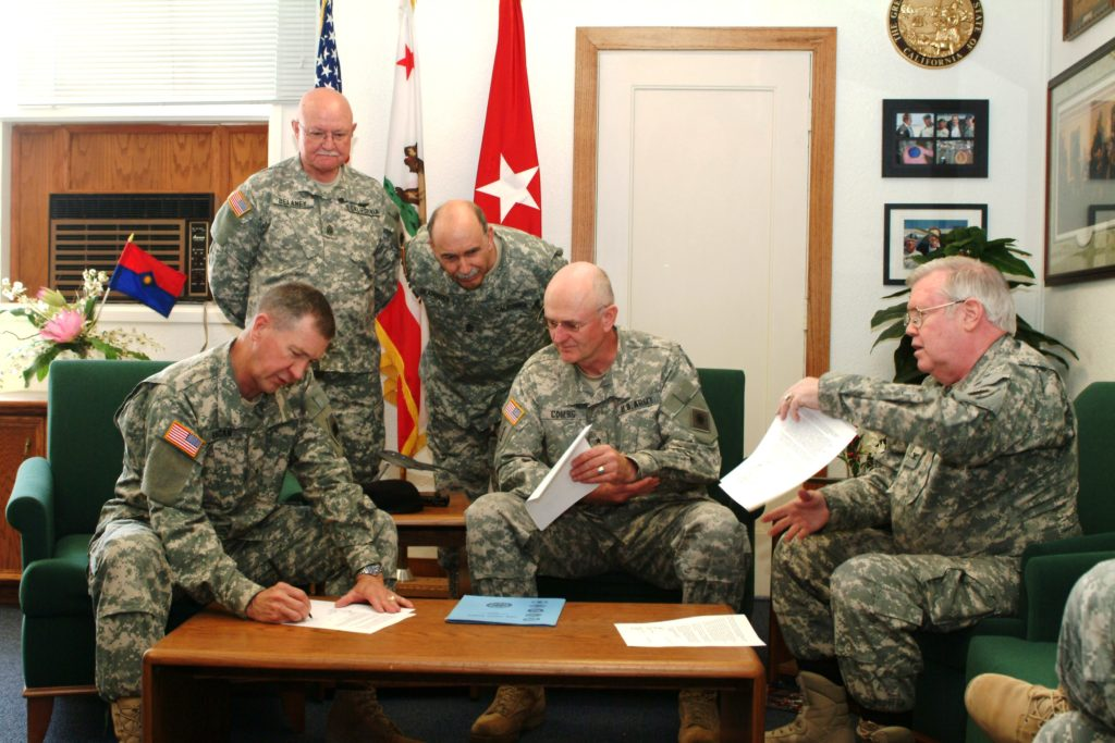 5 California State Guard members in meeting