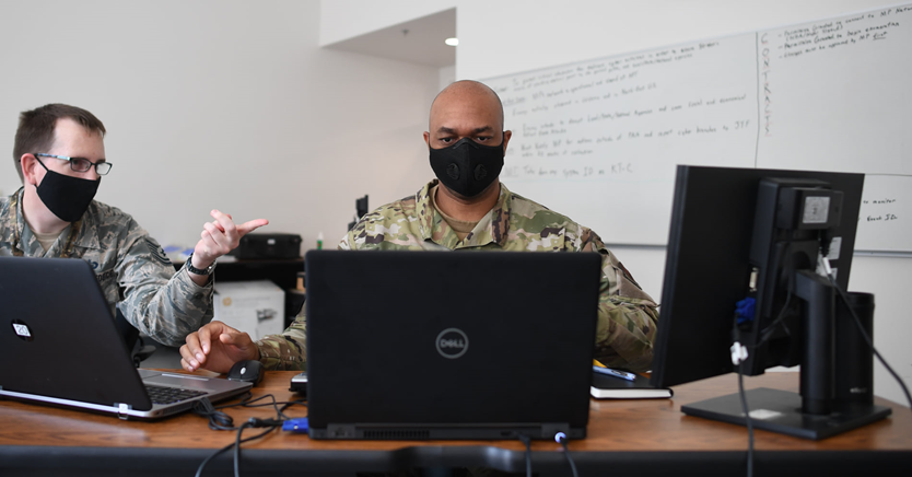 Military Personnel working with computers